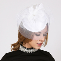 WHITE ELEGANT WEDDING FASCINATOR WITH FLORAL CENTER