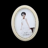 PEARL OVAL FRAME W/DIAMONDS 5X7