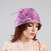Sm bucket sinamay hat w/ rose center and feather