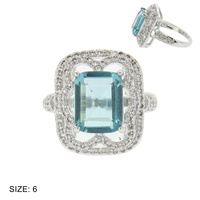 ENGAGEMENT STYLE RING W/ EMERALD CUT CENTER STONE